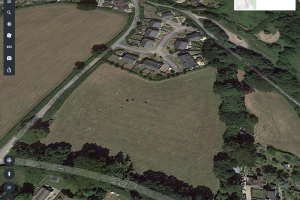 The proposed site in the foreground with the existing Seaway Head development beyond and Old Sidmouth Road to the left.
